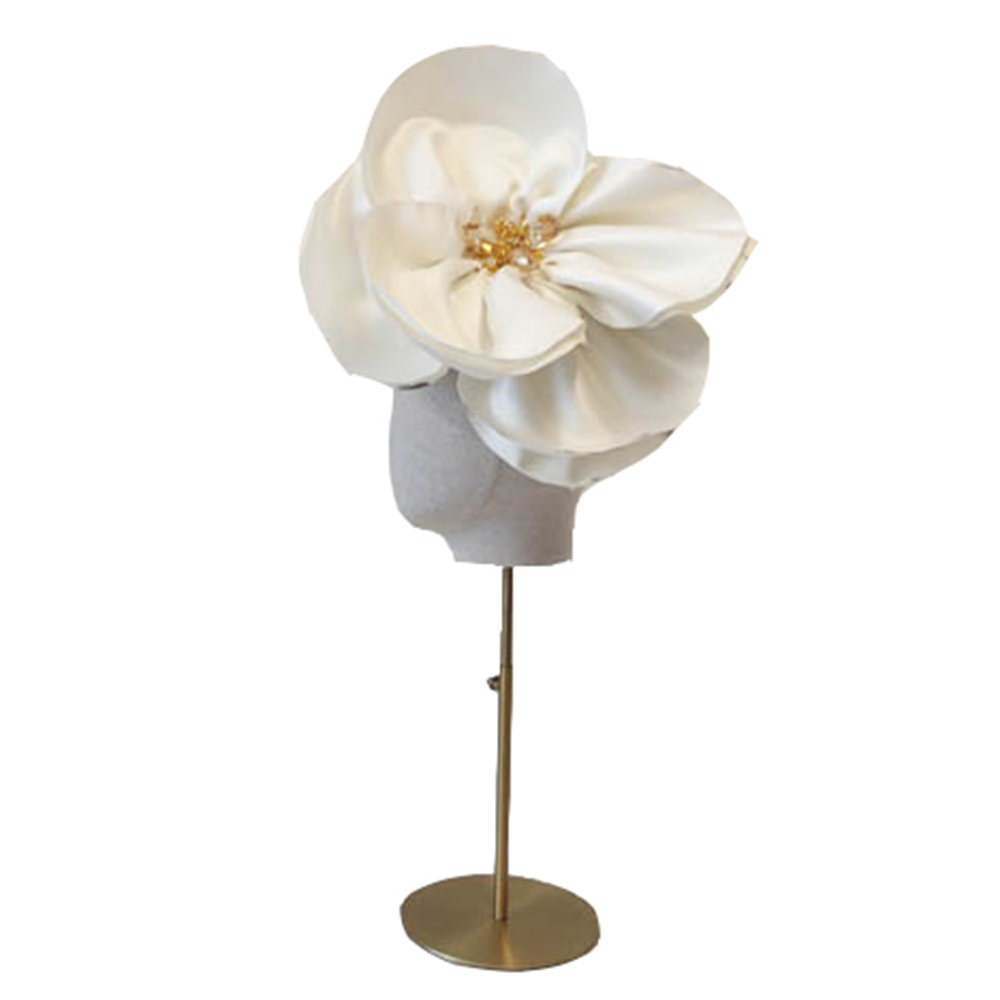 ivory flower head dress made by Bee Smith in her hat hire range